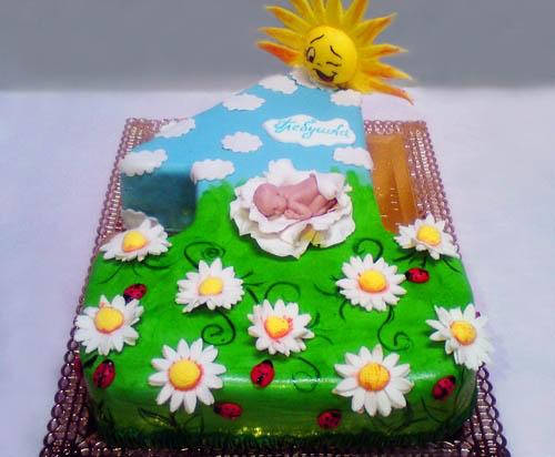 Торт малыш лежит на полянке-единичке